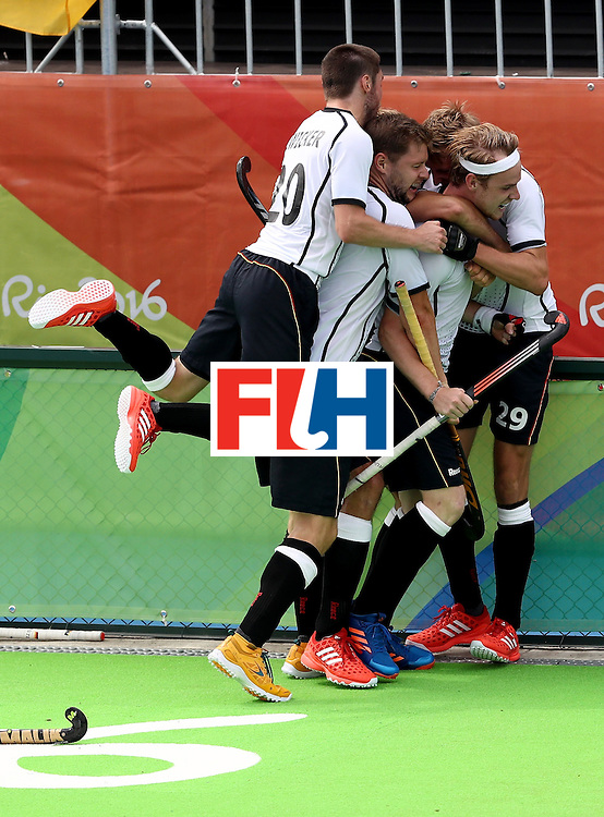 RIO DE JANEIRO, BRAZIL - AUGUST 08:  Christopher Ruhr #17, Martin Zwicker #20, Niklas Wellen #29 and Martin Haner #6 of Germany celebrate a goal against India during a Men's Pool B match on Day 3 of the Rio 2016 Olympic Games at the Olympic Hockey Centre on August 8, 2016 in Rio de Janeiro, Brazil.  (Photo by Sean M. Haffey/Getty Images)