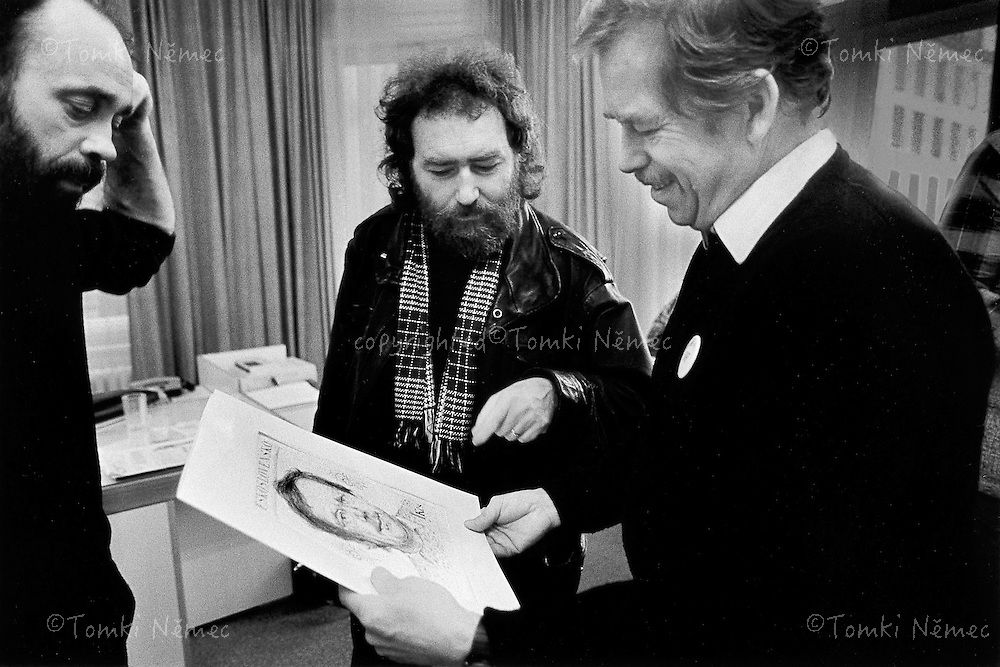 Prague, 1989 - Co-ordinating Centre, Civic Forum.Joska Skalnik presents Vaclav Havel with his design for a one-crown postage stamp bearing the presidential portrait .