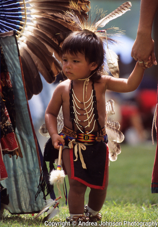 Little boy in traditional Native American clothing participating in dance ceremony at Tamkaliks festival, a three day celebration of traditional Native American culture, Wallowa County, eastern Oregon