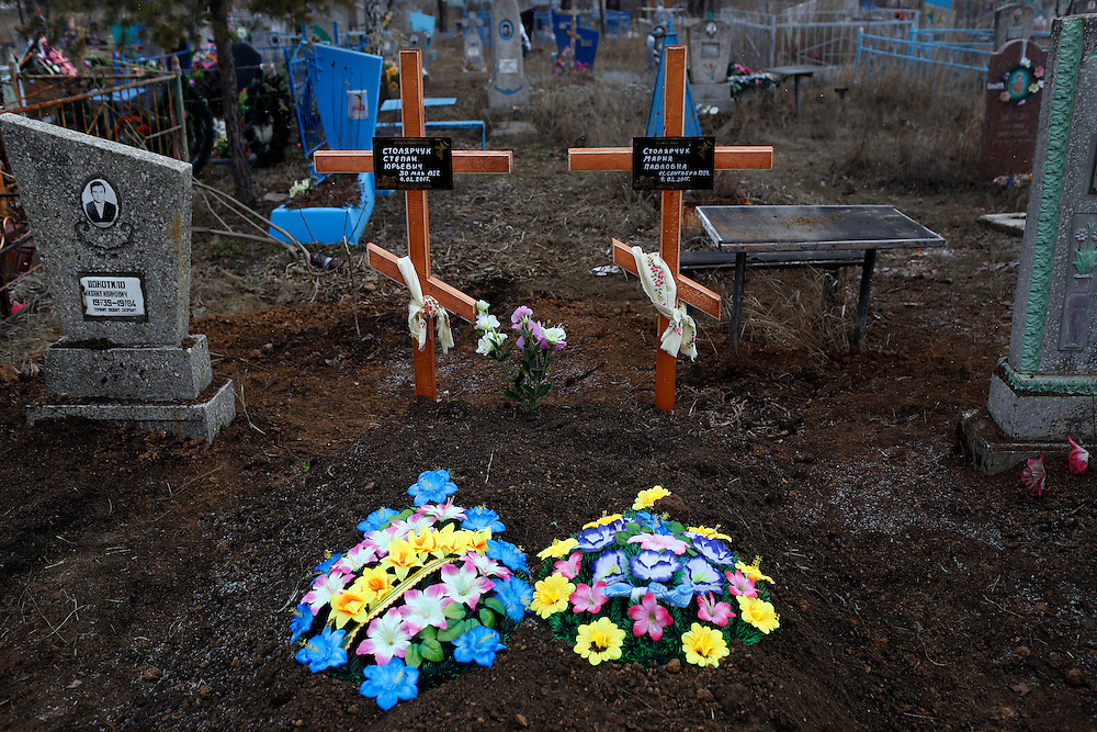 Fresh graves are seen at a cemetery on February 7, 2015 in Luhanske, Donetsk Oblast, Ukraine. Stepan and Mariya Stolyarchuk, 87 and 90, respectively, died on February 5, 2015.