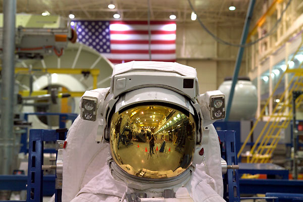 Close-up view of the helmet visor of a space suit in an indoor NASA hangar in Houston, Texas.