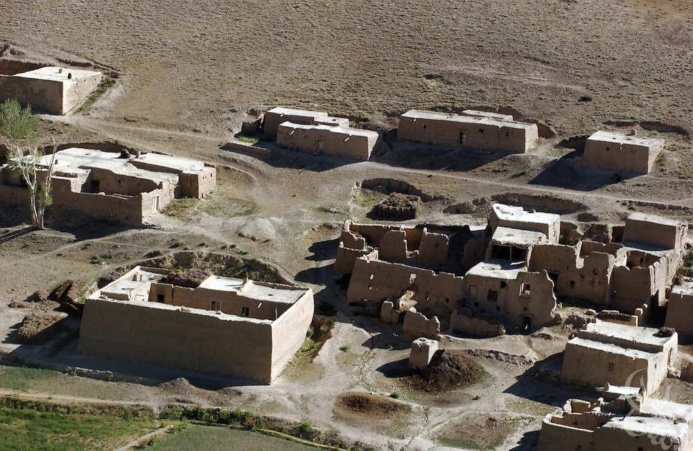 Traditional Afghan mud houses are seen by helicopter within a valley in the remote Baba mountain range  June 17, 2002 near Bamiyan, Afghanistan. Coalition forces continue to scour Afghanistan for traces of remaining al Qaeda and Taliban fighters as part of the ongoing Operation Enduring Freedom.