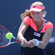 Ekaterina Makarove, Russia, in action against Sara Errani, Italy, during the New Haven Tennis Open at Yale,, Connecticut, USA. 20th August 2013. Photo Tim Clayton