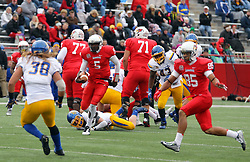 04 October 2014: Tre Roberson clears the pile but Jake Gentile has him in sight. Jake Gentile is being pursued by Lechein Neblett during an NCAA FCS Missouri Valley Football Conference game between the South Dakota State Jackrabbits and the Illinois State University Redbirds at Hancock Stadium in Normal Illinois