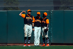 SAN FRANCISCO, CA - AUGUST 26: Hunter Pence #8 of the San Francisco Giants, Steven Duggar #6 and Andrew McCutchen #22 celebrate after the game against the Texas Rangers at AT&T Park on August 26, 2018 in San Francisco, California. The San Francisco Giants defeated the Texas Rangers 3-1. All players across MLB will wear nicknames on their backs as well as colorful, non-traditional uniforms featuring alternate designs inspired by youth-league uniforms during Players Weekend. (Photo by Jason O. Watson/Getty Images) *** Local Caption *** Hunter Pence; Steven Duggar; Andrew McCutchen
