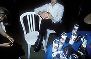 Young man sitting at a table filled with empty beer cans at Glamorgan University ball in Treforest, Wales, 1998