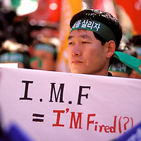 Office workers protesting against the International Monetary Fund (IMF) during the Korean economic crisis.