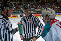 KELOWNA, CANADA - JANUARY 7: Linesmen Dustin Minty and Cody Wanner stand on the ice and speak to Kole Lind #16 of the Kelowna Rockets against the Kamloops Blazers on January 7, 2017 at Prospera Place in Kelowna, British Columbia, Canada.  (Photo by Marissa Baecker/Shoot the Breeze)  *** Local Caption ***