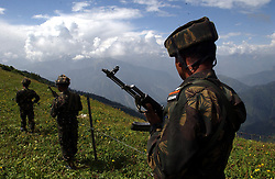 KUPWARA, KASHMIR - AUGUST 18: Indian Army soldiers demonstrate a patrol along the Line of Control in the Keran Sector of the Kupwara District in the Indian held state of Jammu and  Kashmir August 18, 2002.  Indian Army troops killed 7 militants early yesterday morning as they attempted to infiltrate from Pakistan along the Line of Control. They carried with them a large quantity of ammunition, arms and jehadi literature.   (Photo by Ami Vitale/Getty Images)