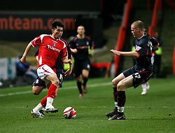 London, England - Tuesday, January 29th, 2008:  Charlton Athletic's Zheng Zhi in action against Stoke City's Ryan Shawcross during the Coca Cola Championship match at The Valley. (Pic by Chris Ratcliffe/Propaganda)