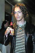 Brandon Boyd of Incubus with his root beer backstage at KROQ's Dysfunctional Family Picnic Concert at Jones Beach Theater in Long Island, NY; June 8, 2002. Photo by Sara Jaye/PictureGroup