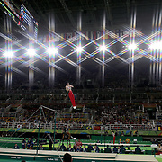 Gymnastics - Olympics: Day 3  Kohei Uchimura #154 of Japan performing his Horizontal Bar routine during the Artistic Gymnastics Men's Team Final at the Rio Olympic Arena on August 8, 2016 in Rio de Janeiro, Brazil. (Photo by Tim Clayton/Corbis via Getty Images)<br /> <br /> (Note to editors: A special effects starburst filter was used in the creation of this image)