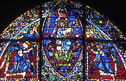 Virgin and Child flanked by angels. Chartres Cathedral, France. French Gothic. 12th century stained glass.