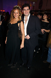 CHARLOTTE DELLAL and ZAFAR RUSHDIE at a party to celebrate the launch of a range of leather accessories designed by Giles Deacon for Mulberry held at Harvey Nichols, Knightsbridge, London on 30th October 2007.<br /><br />NON EXCLUSIVE - WORLD RIGHTS