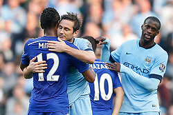 Frank Lampard of Manchester City hugs Mikel John Obi of Chelsea after scoring against his former club to make it 1-1 - Photo mandatory by-line: Rogan Thomson/JMP - 07966 386802 - 21/08/2014 - SPORT - FOOTBALL - Manchester, England - Etihad Stadium - Manchester City v Chelsea FC - Barclays Premier League.