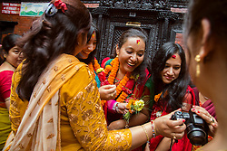 "Seven retired Royal Kumaris are honored inside Kathmandu Durbar Square in the morning of the final day of Kumāri Jātrā, where the Royal Kumari is taken around the city in a chariot procession among thousands of the country's Hindus and Nepali Buddhists. The word Kumari literally means ""virgin"" in Nepali. These living goddesses are young, pre-pubescent girls who are considered to be incarnations of the Hindu goddess of power, Kali.  <br /> <br /> Contract for story is Kashinath Tamot, kashinath.tamot@nepalmandal.org and Sangeeta Lama, sangeetala@gmail.com ."