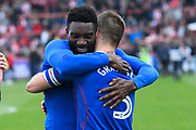 Jabo Ibehre (14) of Carlisle United and Danny Grainger (3) of Carlisle United celebrate at full time after the 3-2 win over Exeter which put them in the play offs during the EFL Sky Bet League 2 match between Exeter City and Carlisle United at St James' Park, Exeter, England on 6 May 2017. Photo by Graham Hunt.