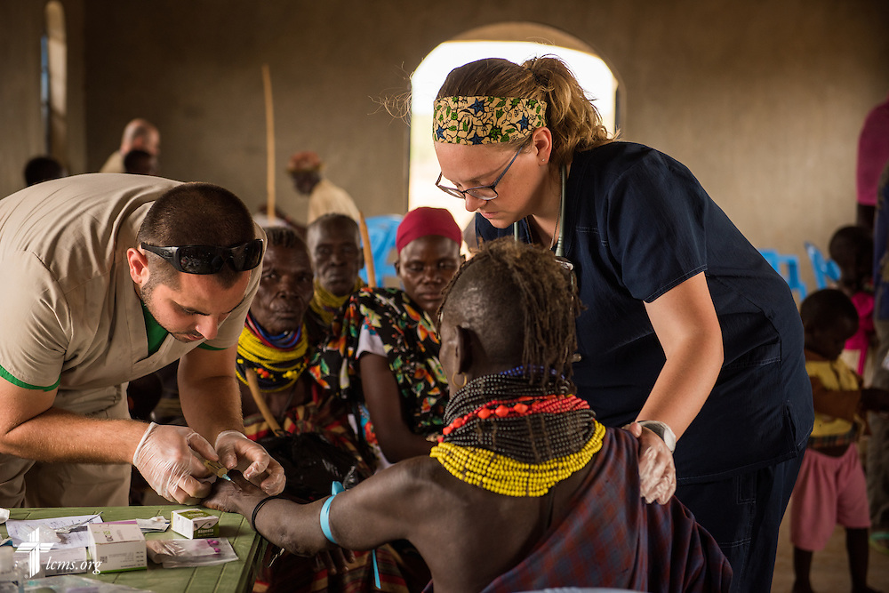 Sarah Kanoy, a career missionary in East Africa, and Shane Lund, a firefighter paramedic and a member of Faith Lutheran Church, Merritt Island, Fla., work together during the LCMS Mercy Medical Team on Tuesday, June 21, 2016, in Nataparkakono, a village in Turkana, Kenya.  LCMS Communications/Erik M. Lunsford