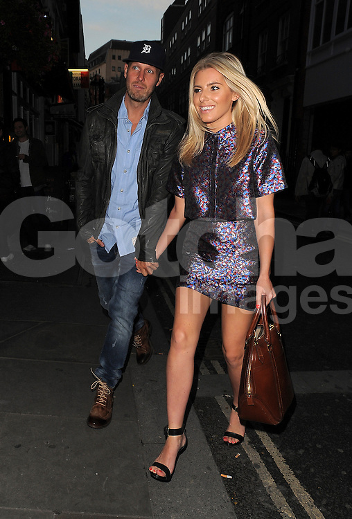The Saturdays singer Mollie King and her new boyfriend American music producer, Jordan Omley, leaving the Piccadilly Theatre after watching Dirty Dancing. London, UK. 06/09/2013<br />BYLINE MUST READ : GOTCHAIMAGES.COM<br /><br />Copyright by &copy; Gotcha Images Ltd. All rights reserved.<br />Usage of this image is conditional upon the acceptance <br />of Gotcha Images Ltd, terms and conditions available at<br />www.gotchaimages.com