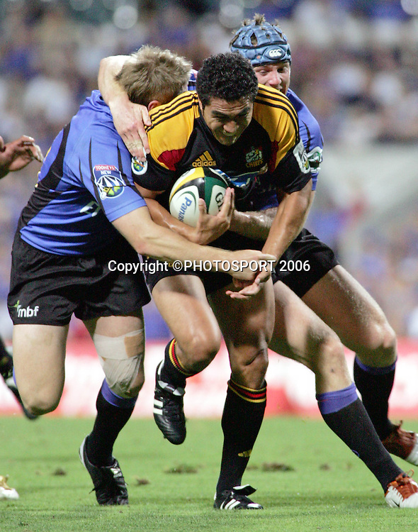 Chiefs fullback Mils Muliaina on the charge during the 2006 Super 14 rugby union match between the Western Force and the Chiefs at Subiaco Oval, Perth, Western Australia, on Friday 24 February, 2006. The Chiefs won the match 26-9. Photo: Christian Sprogoe/PHOTOSPORT<br /><br /><br />240206