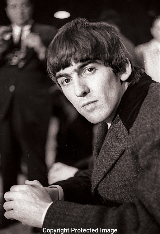 A 40.4 MG FILE FROM FILM OF:.George Harrison.The Beatles First Concert in the United States. Held in what is now a very small ice rink in North East Washington, DC Photo by Dennis Brack