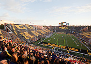 "October 15, 2011: Iowa fans hold up cards showing ""Go Hawks"" on one side right after the National Anthem and before the start of the NCAA football game between the Northwestern Wildcats and the Iowa Hawkeyes at Kinnick Stadium in Iowa City, Iowa on Saturday, October 15, 2011. Iowa defeated Northwestern 41-31."