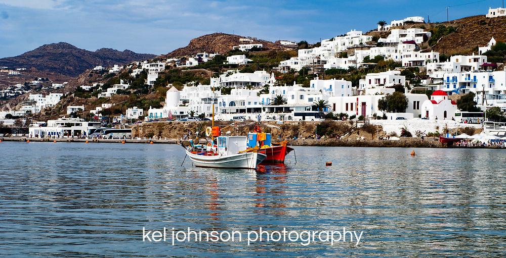Colorful fishing boats in Port, Mykonos Greece