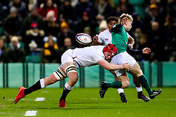 Lewis Finlay of Ireland U20 is tackled by Richard Capstick of England U20 - Rogan/JMP - 21/02/2020 - Franklin's Gardens - Northampton, England - England U20 v Ireland U20 - Under 20 Six Nations.