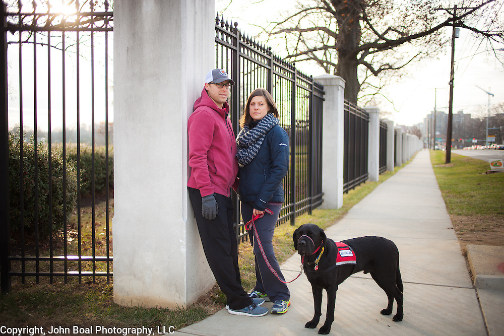 Jessica and Patrick Downes near the Walter Reed National Military Medical Center, with her service dog, Rescue, in Bethesda, MD, on December 12, 2014.  Both are still recovering from their injuries sustained in the bombing at the Boston Marathon on April 15, 2013.    Each of them sustained injuries requiring the amputation of their left legs.  However, Jessica's recovery has continued to be painful and difficult.  She is considering becoming a double amputee as a remedy.  For the Boston Globe