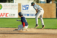 KELOWNA, BC - JULY 24: Nick DiCarlo #16 of the Yakima Valley Pippins catches the ball as Matt Voelzke #5 of the Kelowna Falcons slides into second base at Elks Stadium on July 24, 2019 in Kelowna, Canada. (Photo by Marissa Baecker/Shoot the Breeze)