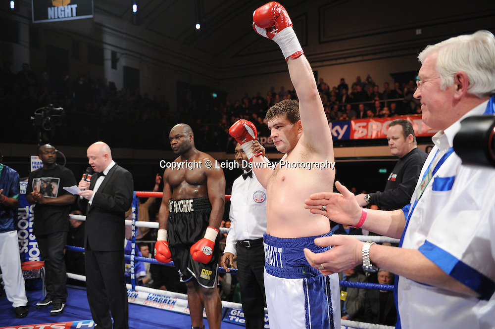 BBBofC Southern Area Heavyweight Title. John McDermott (white shorts) defeats Larry Olubamiwo at York Hall, Bethnal Green, London on the 19th February 2011. Frank Warren Promotions. Photo credit © Leigh Dawney.