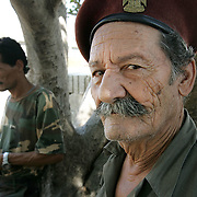 3rd August 2006&amp;#xD;&amp;#xA;Tyre, Lebanon&amp;#xD;&amp;#xA;Refugee Camp&amp;#xD;&amp;#xA;A veteran of previous conflicts in Lebanon who now works as a guard at the Rashidiyeh Camp on the outskirts of Tyre which has become home not only to Palestinian refugees but also the Lebanese people who have fled the towns and villages due to Israeli air strikes The two groups now live side by side and are struggling together through the food and fuel shortages caused by this conflict.<br />