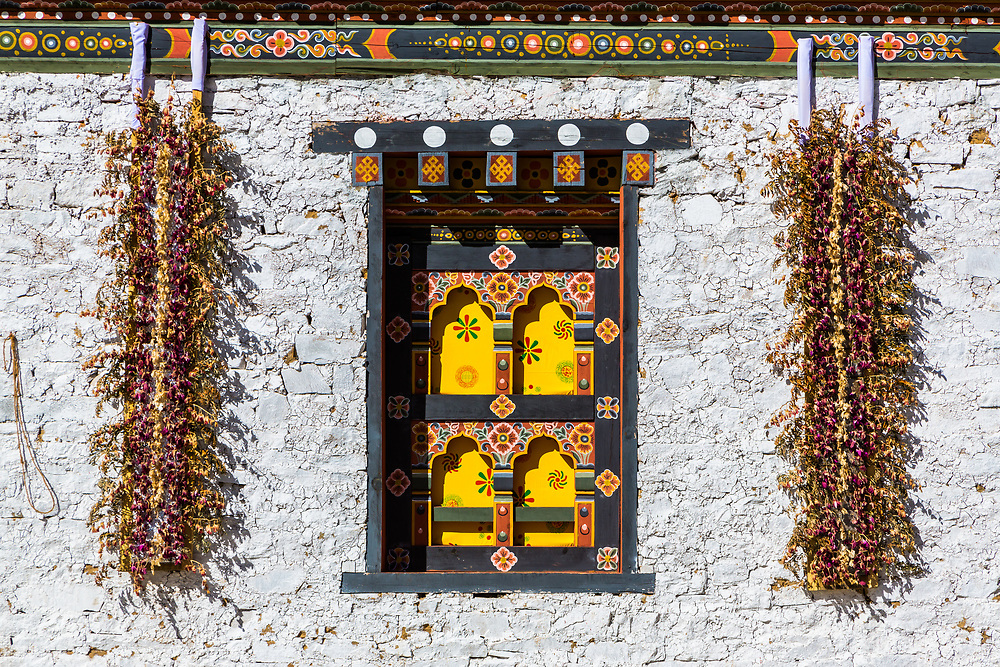 A monastery wall ready for a festival.