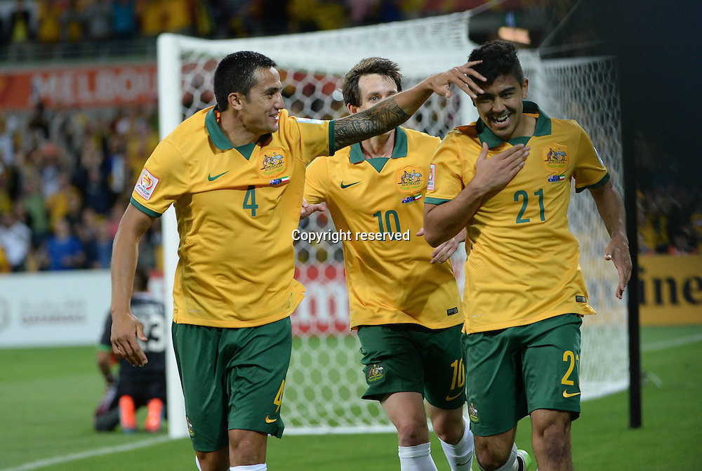 09.01.2015. Melbourne, Australia.  Massimo Luongo (R) of Australia celebrates his goal with Tim Cahill (L) during the opening football match against Kuwait at the AFC Asian Cup in Melbourne, Australia, January 9, 2015. Australia won 4-1.