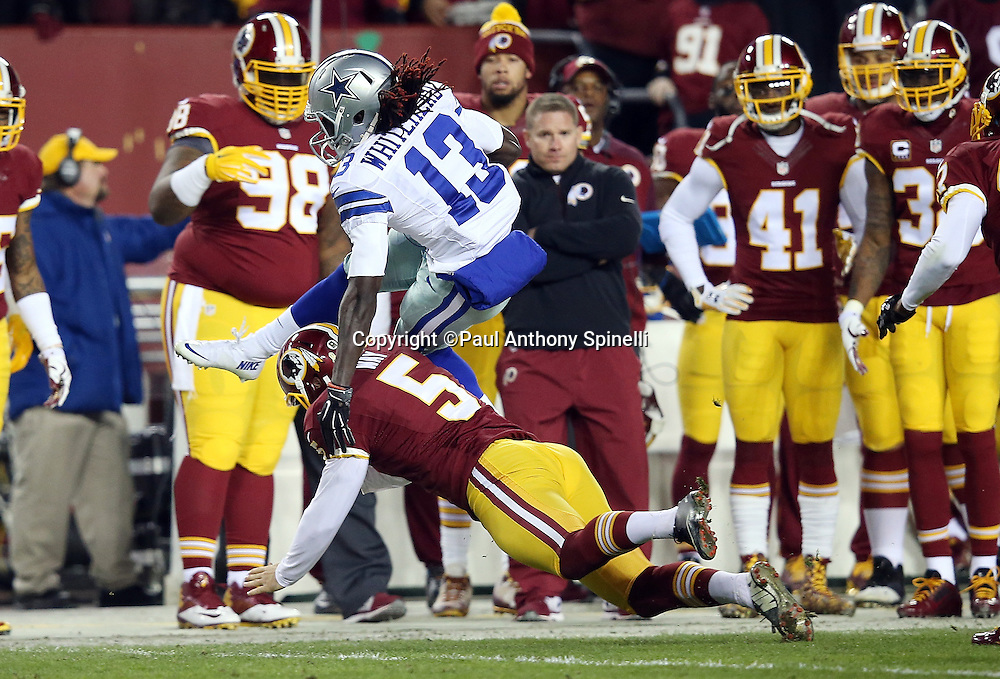 Dallas Cowboys wide receiver Lucky Whitehead (13) tries to leap over Washington Redskins punter Tress Way (5) on a first quarter punt return during the 2015 week 13 regular season NFL football game against the Washington Redskins on Monday, Dec. 7, 2015 in Landover, Md. The Cowboys won the game 19-16. (©Paul Anthony Spinelli)