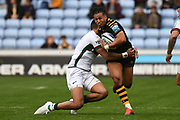 London Irish wing Curtis Rona (13) tackles Wasps winger Marcus Watson (15) during the Gallagher Premiership Rugby match between Wasps and London Irish at the Ricoh Arena, Coventry, England on 20 October 2019.