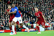 Everton defender Yerry Mina (13) shadowed by Liverpool defender Trent Alexander-Arnold (66) and Liverpool striker Roberto Firmino (9) during the Premier League match between Liverpool and Everton at Anfield, Liverpool, England on 2 December 2018.