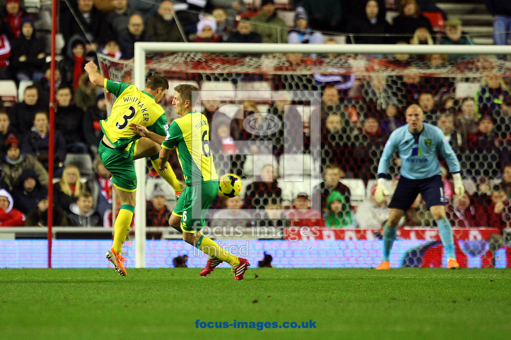 Picture by Paul Chesterton/Focus Images Ltd +44 7904 640267<br /> 21/12/2013<br /> Steven Whittaker of Norwich and Michael Turner of Norwich get in a mix up over clearing the ball during the Barclays Premier League match at the Stadium Of Light, Sunderland.