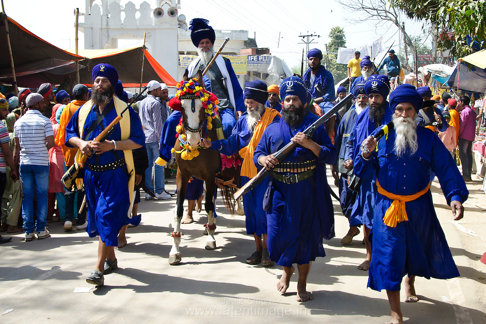 Dressed in new saffron or deep blue robes, the Nihangs move from their chhaawnis.