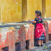 ANTIGUA , GUATEMALA - JULY 30 : Guatemalan girl wash laundry in a traditional street washing facility in Antigua, Guatemala on July 30 2015.