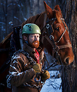WE LIVE HERE: Ian Snider, 34, issues continuous, gentle commands to Jim, a Suffolk Punch work horse who can pull a 3,000-pound load. &ldquo;I have empathy for my working partner,&rdquo; Snider says, &ldquo;which you don&rsquo;t have with a tractor.&rdquo; Owner of Mountain Works Sustainable Development, Snider is a forester who uses horse-power rather than extraction machinery, a method important in situations like this one, a mountainside in the small town of Creston, North Carolina selectively cleared for a bird habitat. He&rsquo;s teaching this &ldquo;tool that&rsquo;s still important to keep in the toolbox for modern forestry,&rdquo; to students at Appalachian State University.<br /> <br />  JERRY WOLFORD and SCOTT MUTHERSBAUGH / Perfecta Visuals<br /> <br /> Photograpphed, Monday, January 9, 2017, in Creston,, N.C. JERRY WOLFORD and SCOTT MUTHERSBAUGH / Perfecta Visuals