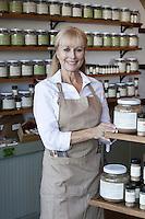 Portrait of a happy senior female employee in spice store