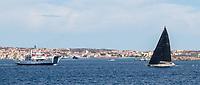 MOMO crossing path with the Palau-Maddalena ferry during the Rolex Maxi Cup 2017, Costa Smeralda, Porto Cervo Yacht Club Costa Smeralda (YCCS).