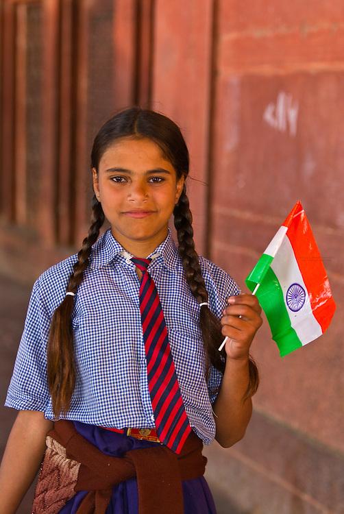 Schoolgirl with Indian flag on Republic Day, The Jama Masjid Mosque, Fatehpur Sikri, Uttar Pradesh, India