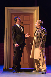 """© Licensed to London News Pictures. 08/10/2014. London, England. Pictured L-R: Steven Serlin as Rabbi and Kev Orkian as Mahmoud. The Musical """"The Infidel"""", based on the same named film by David Baddiel,  premieres at the Theatre Royal Stratford East, London. Directed by David Baddiel and Kerry Michael, book and lyrics by David Baddiel with music by Erran Baron Cohen. The Infidel is a story about Muslim man Mahmoud (Kev Orkian) who discovered that he is not only adopted but also Jewish. Photo credit: Bettina Strenske/LNP"""