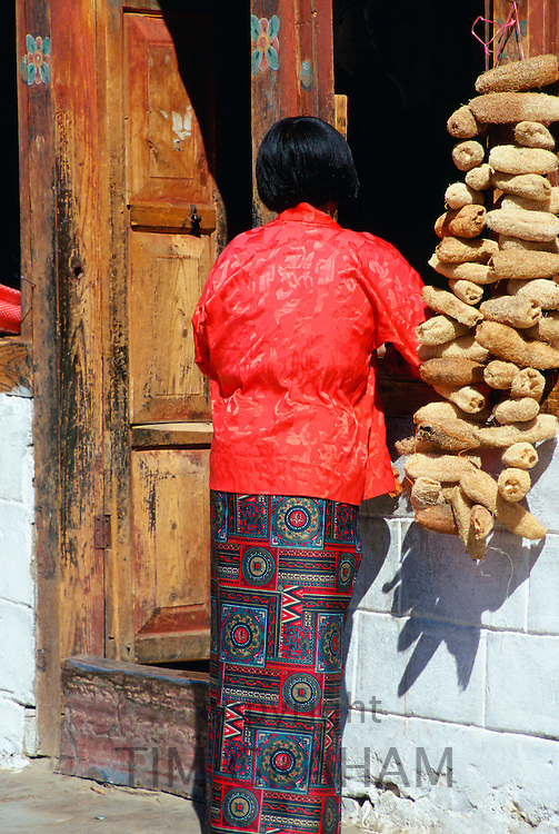 Woman with loofahs, Paro, Bhutan