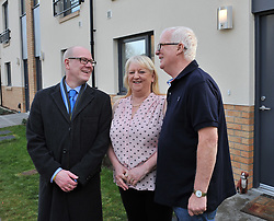 Housing Minister Kevin Stewart chats to new tenants Mary and John Stewart as he visits a major affordable housing development in Muirhouse, Edinburgh to coincide with the release of the latest quarterly housing statistics.<br /> <br /> &copy; Dave Johnston/ EEm