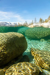 """Boulders Under Lake Tahoe 2"" - Over/Under photograph of boulders under the surface of Lake Tahoe."