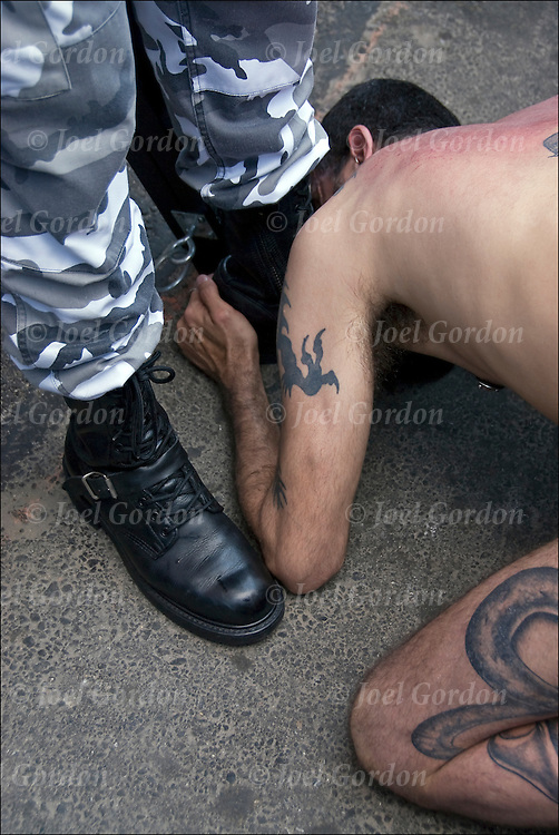 "S&M slave kissing master's boot after whipping.   Master / Slave emotional release after cathartic flogging. The flogging brings out a release of emotions usually by a crying. Hugging is the ""aftercare"" where the slave feels safe and protected. Folson Street East S&M Fair in New York City."