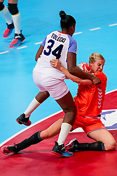 03-12-2019 JAP: Netherlands - Cuba, Kumamoto<br /> Third match 24th IHF Women's Handball World Championship, Netherlands win the third match against Cuba with 51- 23. / Danick Snelder #10 of Netherlands, Yennifer Amanda Toledo Abreu #34 of Cuba
